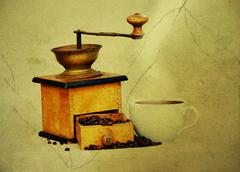 Coffee mill and cup of hot black coffee Stock Photos