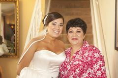 Hispanic bride standing with mother Stock Photos