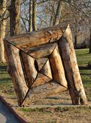wood composition at the park with greenery. - stock photo