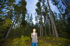Caucasian woman standing in forest Stock Photos