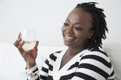 Black woman drinking white wine Stock Photos