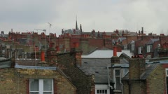 House rooftops with sky Stock Footage