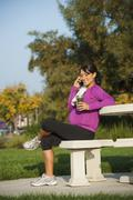 Pregnant Hispanic woman talking on cell phone - stock photo