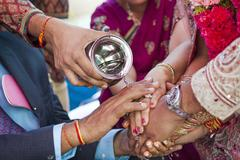 Indian couple performing wedding ceremony Stock Photos