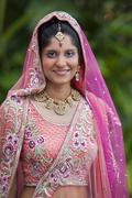 Indian bride smiling - stock photo