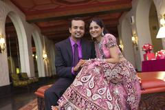 Indian newlywed couple smiling - stock photo