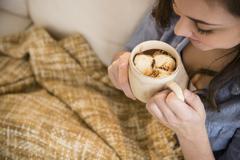 Hispanic girl drinking hot chocolate Stock Photos