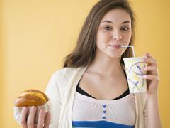Hispanic girl having fast food Stock Photos