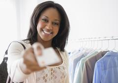 African American woman paying with credit card Stock Photos