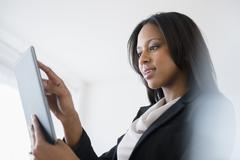 African American businesswoman using tablet computer - stock photo