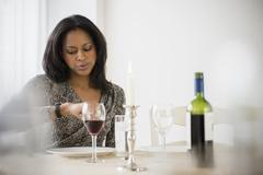 African American woman waiting for date Stock Photos