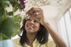 Stock Photo of African American woman arranging flowers