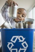 African American boy recycling aluminum cans - stock photo