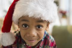 African American boy wearing Santa hat Stock Photos