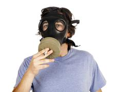 Smoking with gas mask Stock Photos