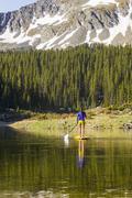 Stock Photo of Hispanic woman riding paddle board