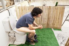 Using rooftop lavatory Stock Photos