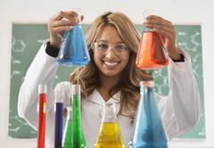 Mixed race student working in chemistry lab Stock Photos
