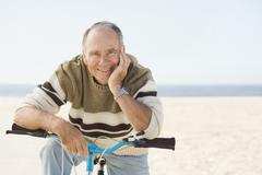 Caucasian man sitting on bicycle Stock Photos