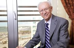 Stock Photo of senior businessman smiling to camera