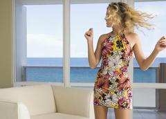 Caucasian woman dancing in living room Stock Photos