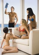 Stock Photo of Women in bikinis admiring window washer