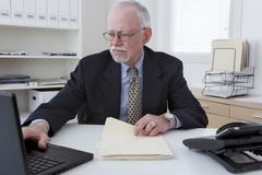 Caucasian businessman working in office - stock photo