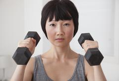 Chinese woman lifting weights Stock Photos