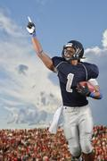 African American football player cheering in game - stock photo