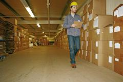 Caucasian worker checking product in warehouse Stock Photos