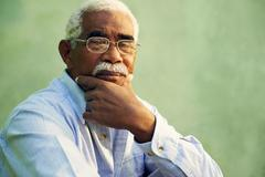 portrait of serious african american old man looking at camera - stock photo