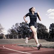 African American woman running on track Stock Photos