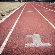 First lane on athletic track Stock Photos