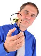 Business man holding idea light bulb Stock Photos