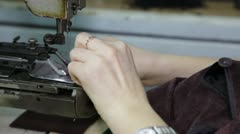 The seamstress sews spare buttons for a jacket. Stock Footage