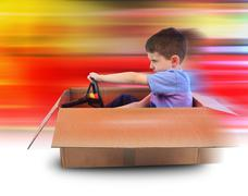 boy speed driving in box car - stock photo