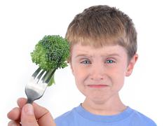 Boy and healthy broccoli diet on white Stock Photos