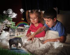 animals at bed time with children - stock photo