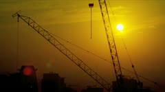 Stock Video Footage of Working Construction Cranes Sunrise Silhouette Dubai
