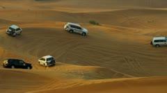 4x4 Vehicles Driving Across Dubai Desert Sands Stock Footage