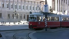 Red Tram going round a bend in Vienna town center Stock Footage