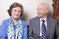 Stock Photo of a high society senior couple (he's in his 80's, she's in her late 60's) sitti