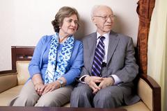 Elderly couple looking away Stock Photos