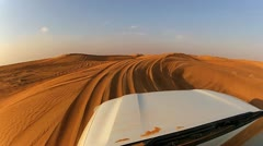 4x4 off road vehicle taking tourists on desert trip, Middle East Stock Footage