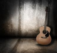 Acoustic music guitar grunge background Stock Photos