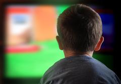 boy child watching television at home - stock photo