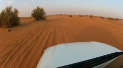 Stock Video Footage of 4x4 off road vehicle taking tourists on desert trip, Middle East
