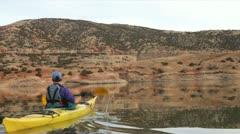 Kayaker paddling Big Horn Lake Stock Footage