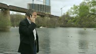 Businessman on cell phone outdoor Stock Footage