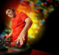 dj spinning dance music at club on turntables - stock photo